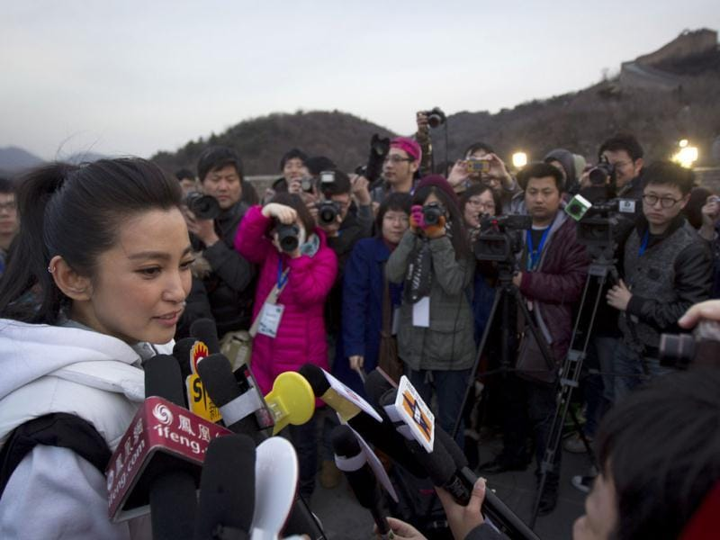 Chinese actress Li BingBing, left, speaks to the media before a mini marathon in conjunction during the Earth Hour at the Great Wall of China in the north of Beijing, China. Hundreds of landmarks around the world including Washington's National Cathedral, London's Clock Tower, the Great Wall of China and Tokyo Tower will be dimmed at 8:30 pm local time, as part of a global effort to shine a spotlight on climate change. AP Photo/ Vincent Thian