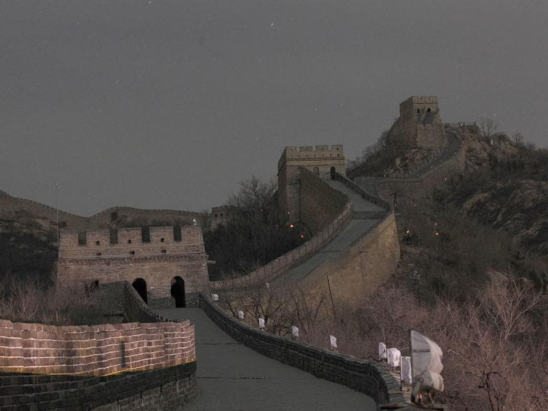 The Great Wall of China went dark as the landmark switched off the lights to mark 'Earth Hour' as part of a global effort to shine a spotlight on climate change in north of Beijing, China. AP Photo/ Vincent Thian