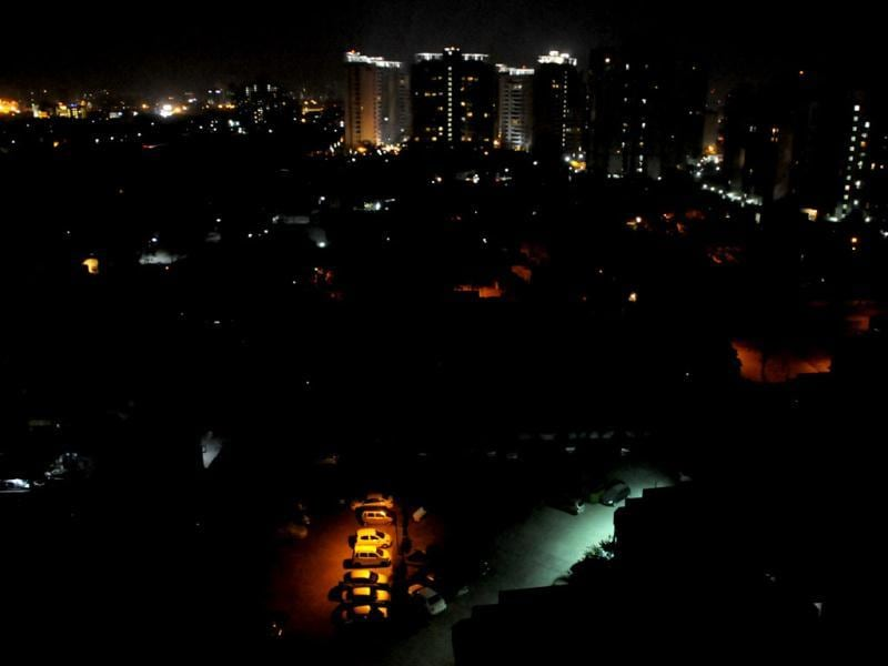 "High-rise buildings in the dark during the ""Earth Hour"" in Gurgaon on Saturday. HT Photo by Parveen Kumar"