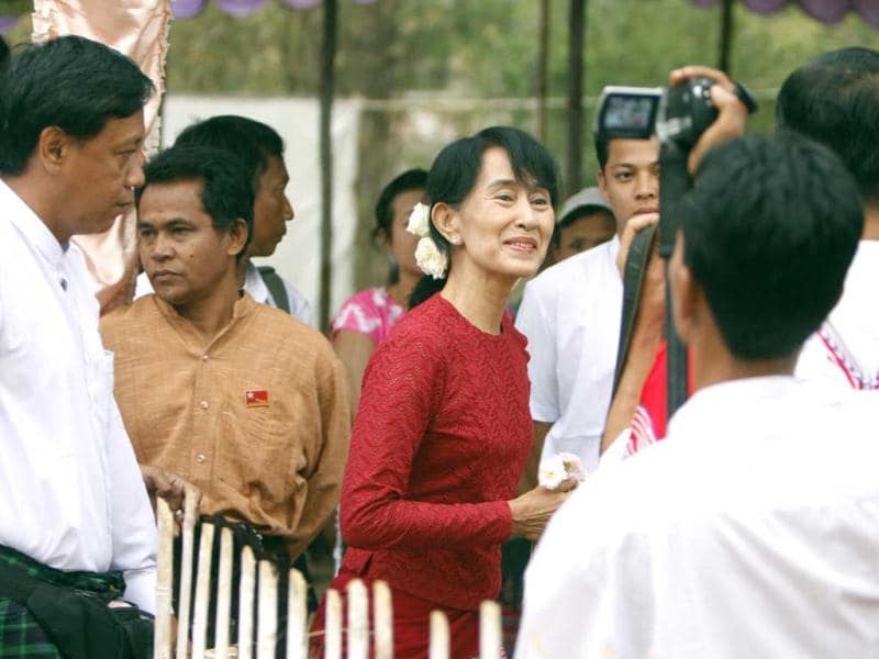 Myanmar's National League for Democracy party leader Aung San Suu Kyi heads towards a polling station at Wah Thin Kha village in Yangon. AP