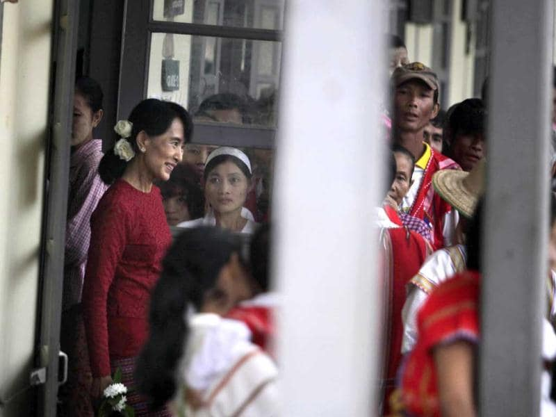 Myanmar's pro-democracy leader Aung San Suu Kyi leaves a polling station in the village of Wah Thin Kha. AP/Altaf Qadri