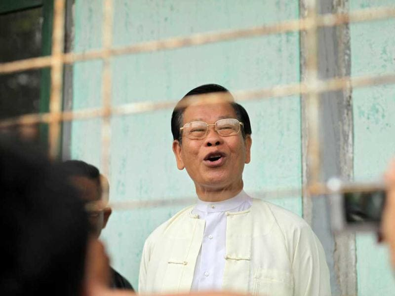 Former Myanmar prime minister and military intelligence chief Khin Nyunt arrives to cast his vote at a polling station in Yangon. AFP/Ye Aung Thu