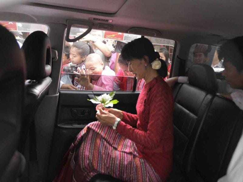 Myanmar's pro-democracy leader Aung San Suu Kyi leaves a polling station in her car in the village of Wah Thin Kha, Myanmar. AP/Altaf Qadri
