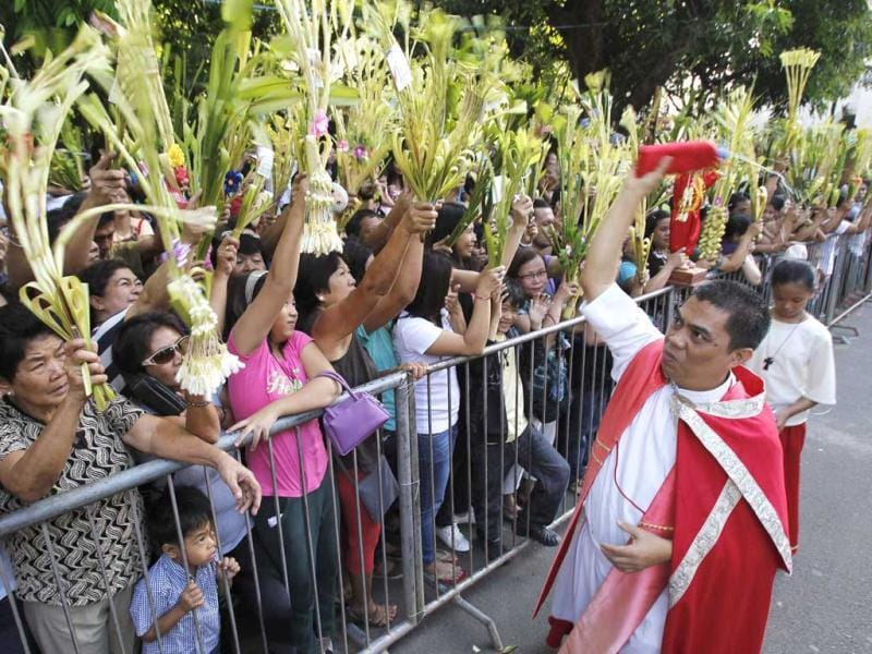Devotees wave palm fronds as priest Ariel Lubi blesses it with holy water at a redemptorist church to celebrate Palm Sunday in Baclaran town, located in Paranaque city which is part of metro Manila. Reuters Photo/Romeo Ranoco