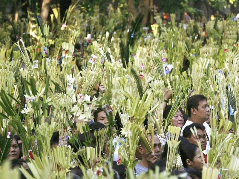 Devotees wave palm fronds as they wait for a priest to bless it with holy water at Redemptorist Church to celebrate Palm Sunday in Baclaran town, located in Paranaque city. Reuters Photo/Romeo Ranoco