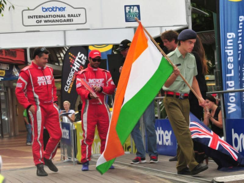 Gaurav Gill's (with sunglasses and cap) car, however refused to start before the ceremonial flag-off, leaving him to improvise a bit with a cardboard cutout. HT Photo/Vinayak Pande