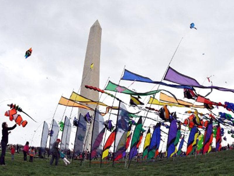 A woman flies a kite near the Washington Monument during the annual Blossom Kite Festival in Wasington, DC. The event is part of the National Cherry Blossom Festival which this year celebrates 100 years of friendship between Japan and the United States. AFP PHOTO/Eva Hambach