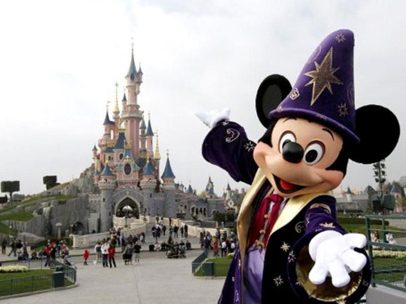 Disney character Mickey poses in front of the Sleeping Beauty Castle at Disneyland park as part of the 20th birthday celebrations of the park, in Chessy, near Marne-la-Vallee, outside Paris. AFP/Thomas Samson