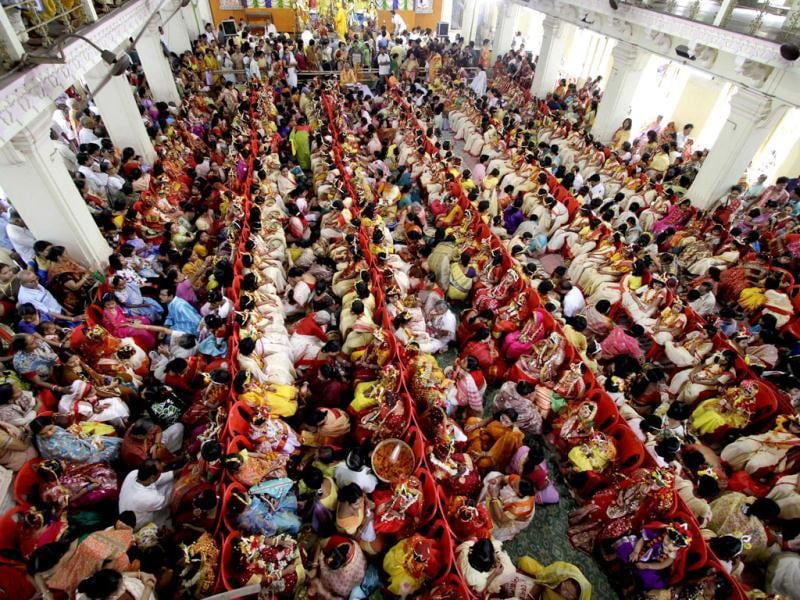 Young Hindu girls sit together as they are worshipped as