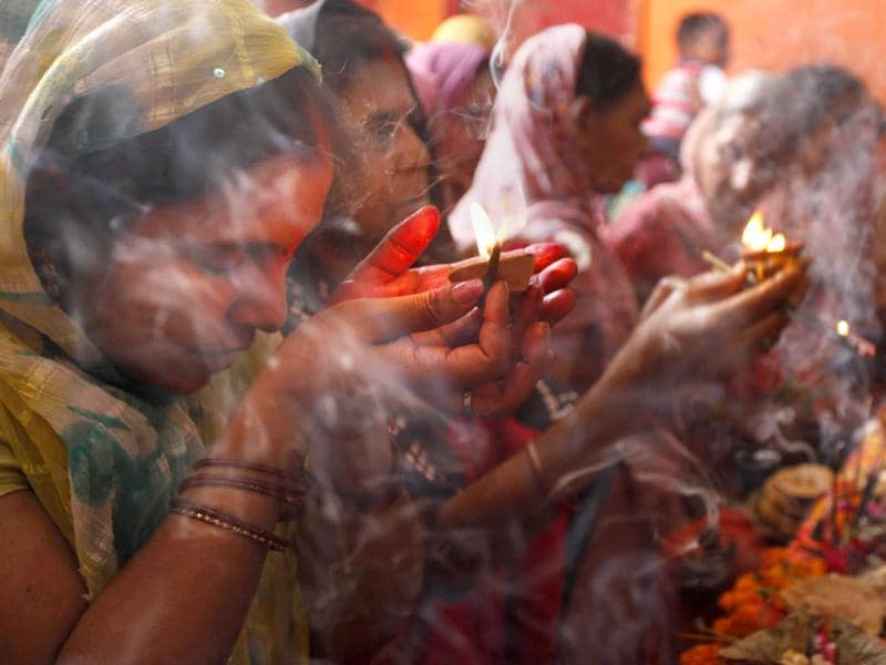 Worshippers pray during the festival of Ram Navami, at a temple in Allahabad,. (AP Photo/Rajesh Kumar Singh)