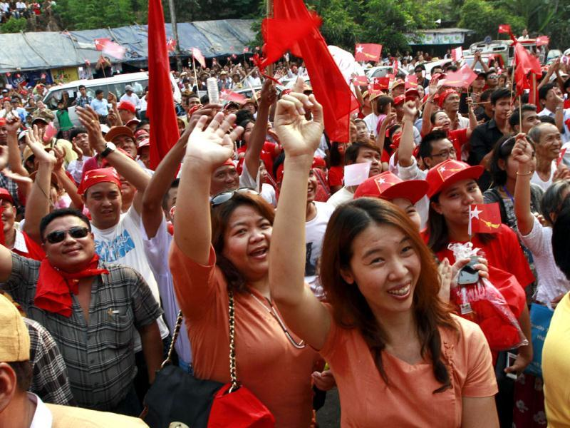 Aung San Suu Kyi's National League for Democracy party supporters cheer upon the party's announcement in Yangon, Myanmar. Supporters of Suu Kyi erupted in euphoric cheers Sunday after her party said she won a parliamentary seat in a landmark election, setting the stage for her to take public office for the first time. (AP Photo/Khin Maung Win)