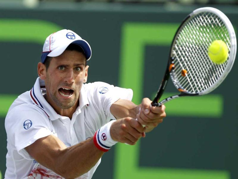 Novak Djokovic hits a return to Andy Murray, during the men's singles final at the Sony Ericsson Open tennis tournament, in Key Biscayne. Djokovic won 6-1, 7-6 (4). (AP Photo)