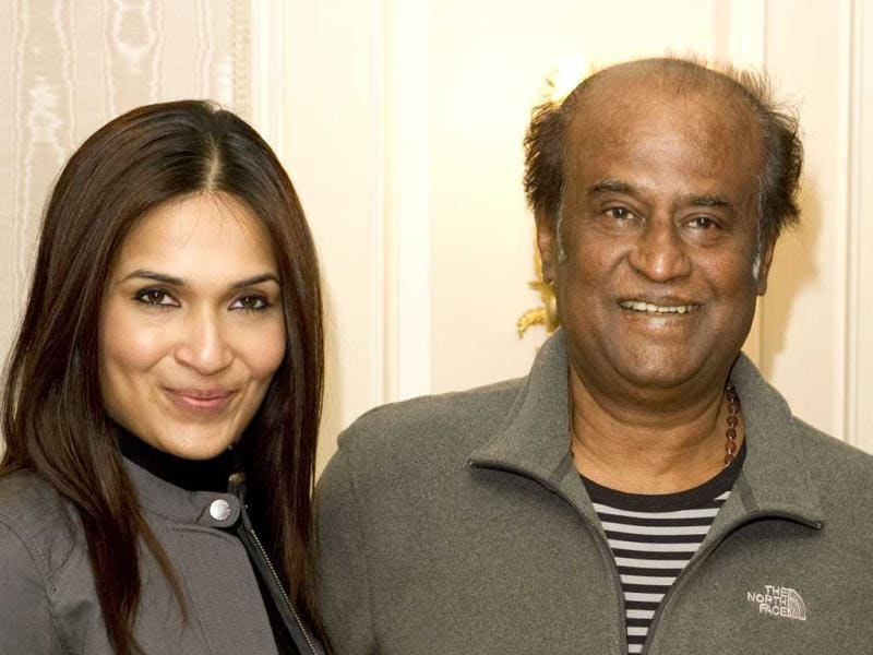 Rajinikanth and daughter Soundarya pose for the cameras.