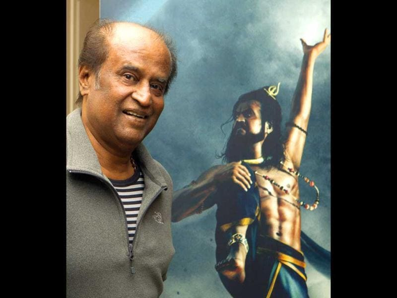The man himself: Rajinikanth poses in front of the Kochadaiyaan poster.