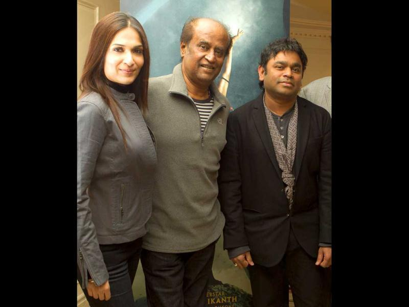 Actor Rajinikanth (centre) poses with his director daughter Soundarya Rajinikanth and music composer AR Rahman (right) at a photo call for Kochadaiyaan: The Legend, at a west London hotel.