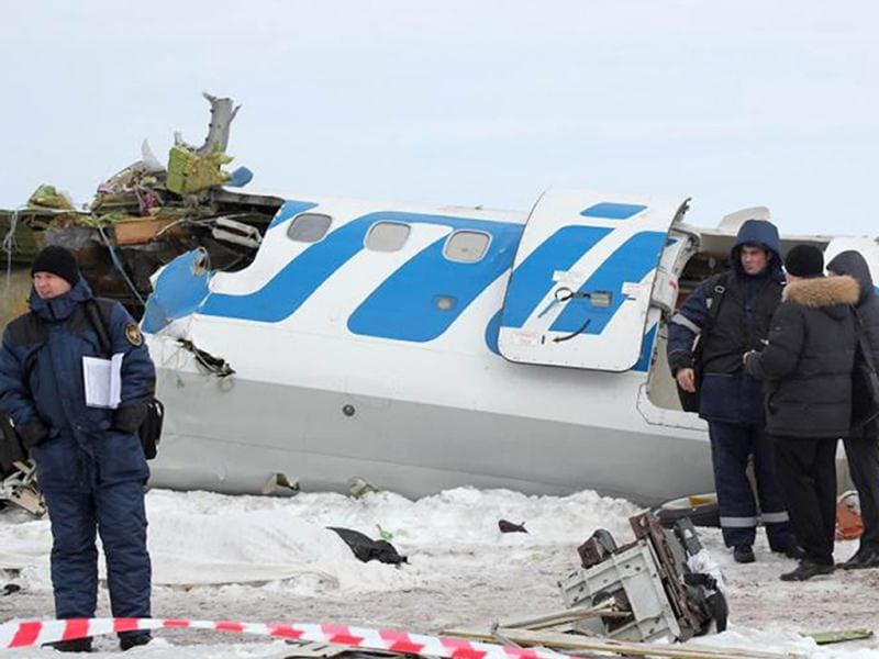 Rescuers and investigators working at the crash site of a French-Italian made ATR-72 passenger plane of private Russian airline UTair, some 45 km (28 miles) from the western Siberian city of Tyumen. AFP