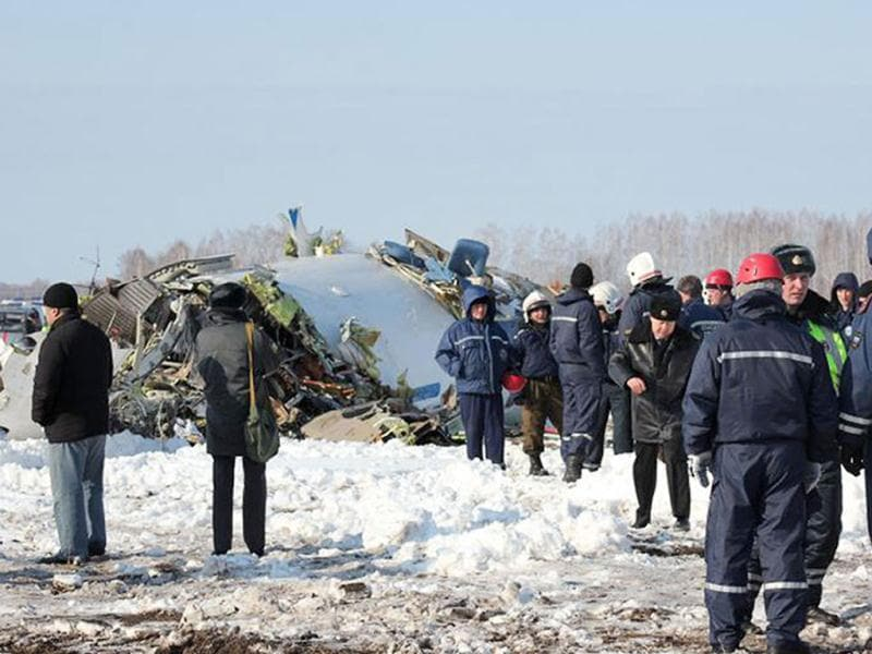 Rescuers and investigators working at the crash site of a French-Italian made ATR-72 passenger plane of private Russian airline UTair, some 45 km from the western Siberian city of Tyumen. Thirty-one people were killed today when a passenger plane crashed moments after take-off in an oil-rich Siberian region in the latest accident to hit Russia's crisis-prone aviation industry. AFP/Russian Emergencies Ministry