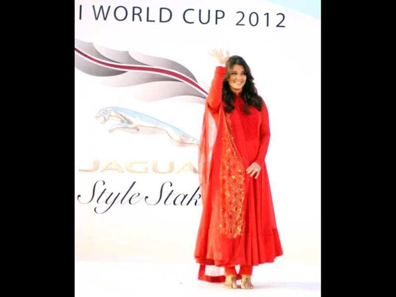 Aishwarya Rai Bachchan was dressed in a red suit by Sabyasachi.