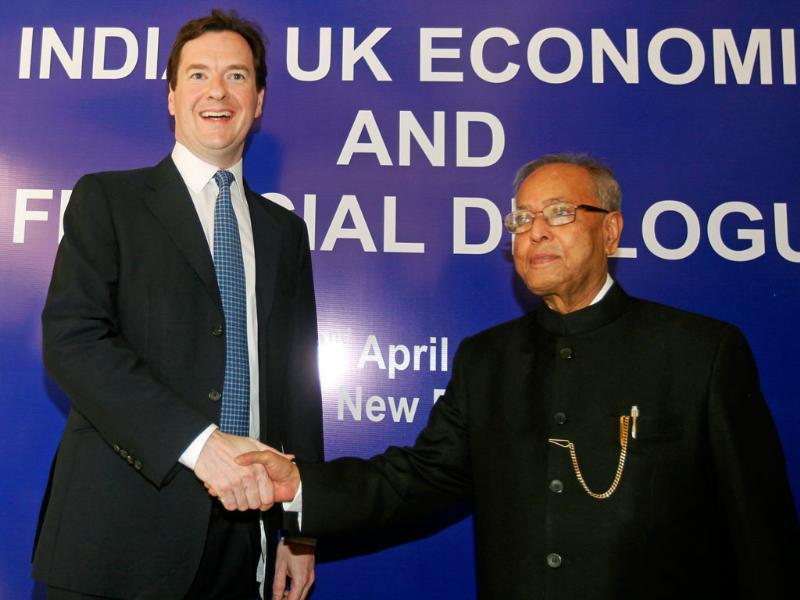 Finance minister Pranab Mukherjee (R) shakes hands with his British counterpart George Osborne before a meeting in New Delhi. AP Photo/ Mustafa Quraishi