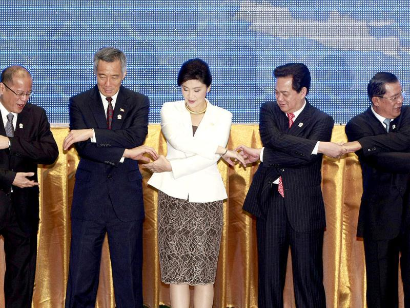 Leaders from the Association of Southeast Asian Nations (ASEAN) from left, Philippine President Benigno Aquino III, Singapore Prime Minister Lee Hsien Loong, Thailand's Prime Minister Yingluck Shinawatra, Vietnam's Prime Minister Nguyen Tan Dung and Cambodia's Prime Minister Hun Sen shake hands for a group photo during the opening ceremony of the 20th ASEAN Summit in Phnom Penh, Cambodia. AP Photo/Apichart Weerawong