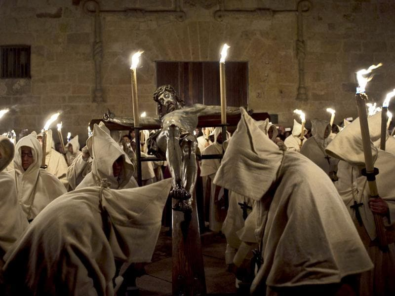 Penitents from Cristo de la Buena Muerte brotherhood participate in a procession in Zamora, Spain. Hundreds of processions take place throughout Spain during the Easter Holy Week. AP Photo/Daniel Ochoa de Olza