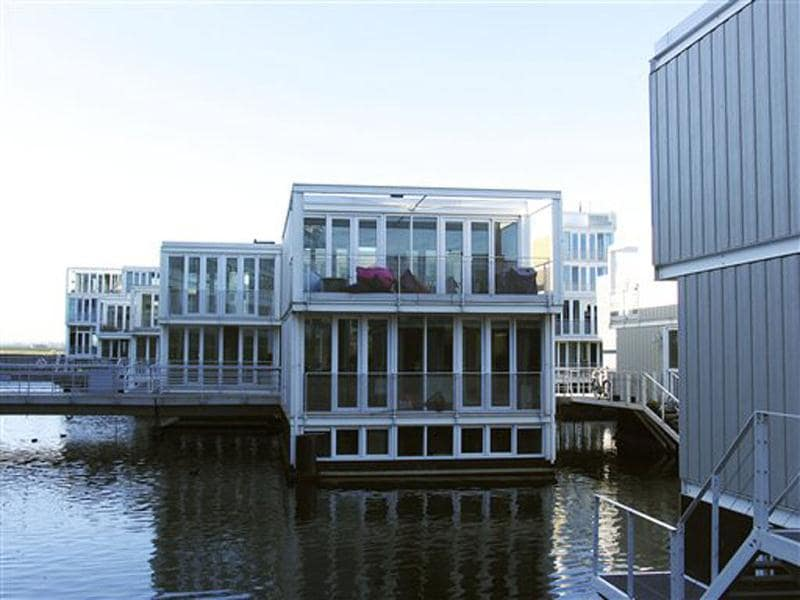 Amphibious houses seen in the harbour of the IJburg neighborhood in Amsterdam. IJburg is a new district in the eastern part of town completely surrounded by water. One third of Netherlands below sea level. AP Photo/Margriet Faber
