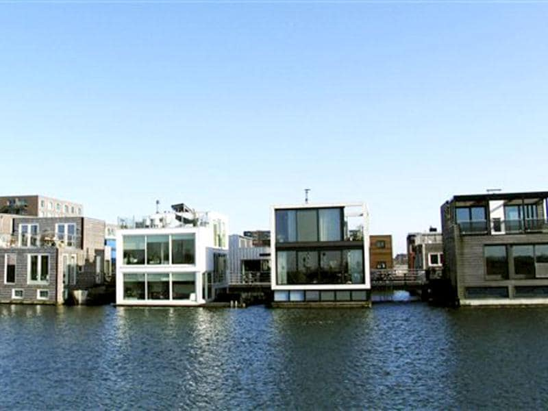 Amphibious houses float on the harbour in the IJburg neighborhood in Amsterdam. AP Photo/Margriet Faber