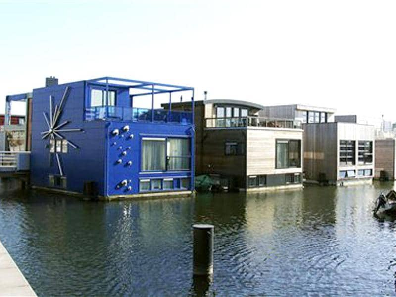 Amphibious homes float on the harbour in the IJburg neighborhood in Amsterdam. AP Photo/Margriet Faber