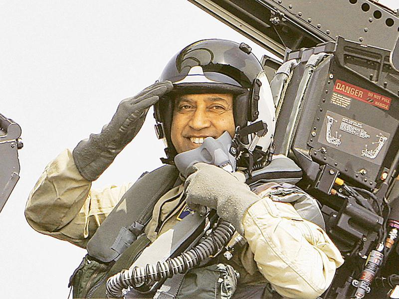 Astronaut Rakesh Sharma gestures from the cockpit of a US fighter jet F-18 before flying in it at the 'Aero India 2009' in Yelahanka air base on the outskirts of Bangalore.(AP Photo/Aijaz Rahi)