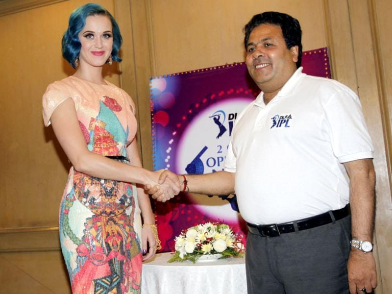 US singer Katy Perry, left, shakes hand with Indian Premier League chairman Rajiv Shukla during a photo opportunity at the IPL opening ceremony in Chennai. IPL 2012 will feature 76 Twenty20 games across 12 venues. AP/Aijaz Rahi