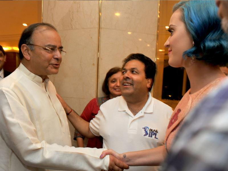 US singer Katy Perry (R) shakes hands with senior BJP leader Arun Jaitley as IPL chairman Rajiv Shukla looks on at a hotel in Chennai. The 27 year-old singer is in India to perform for the first time at the opening ceremony of the fifth Indian Premier League. AFP/Manjunath Kiran