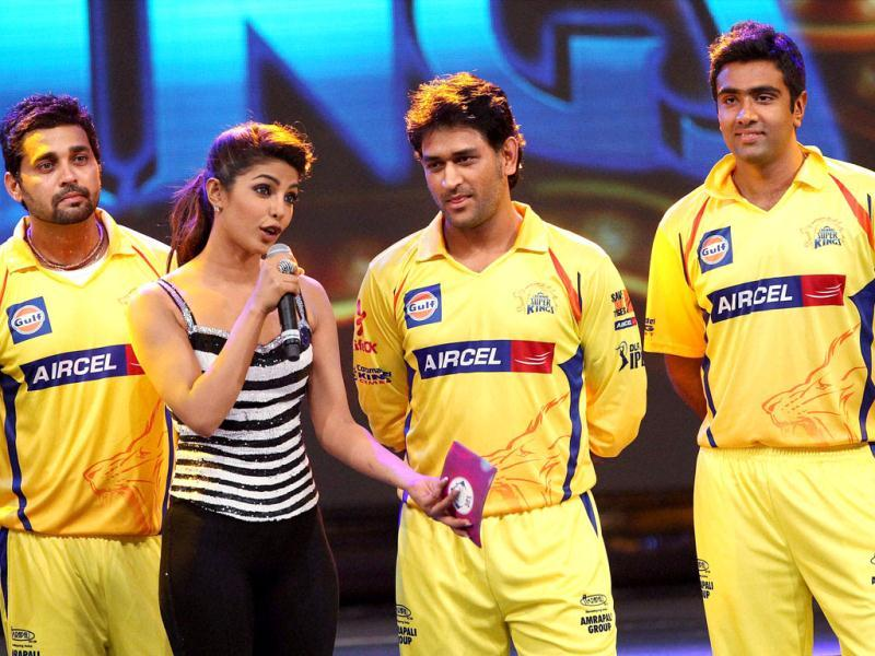 Actress Priyanka Chopra talks to MS Dhoni and other CSK players during the opening ceremony of the 5th edition of Indian Premier League in Chennai. PTI/TV grab
