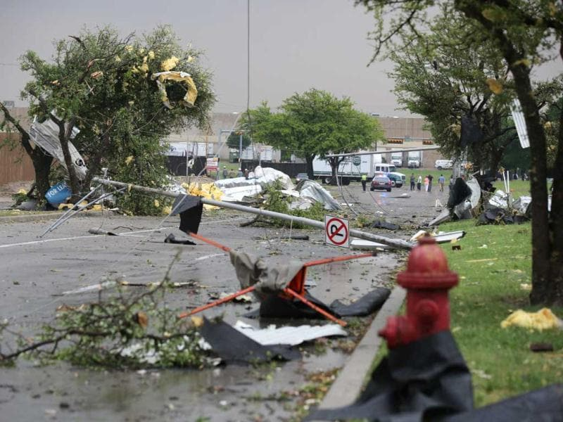 A pole and branches are scattered on the ground after a storm passed through in Arlington, Texas. AP Photo/Nathan Hunsinger