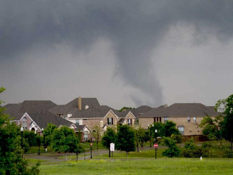 A funnel cloud begins to form in southern Dallas county before a tornado touched down in Lancaster, Texas. AP Photo/Parrish Velasco.