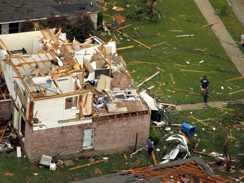This aerial photo shows damage from a tornado in Lancaster, Texas just south of Interstate 20 near Bonnie View Road. AP Photo/Vernon Bryant.