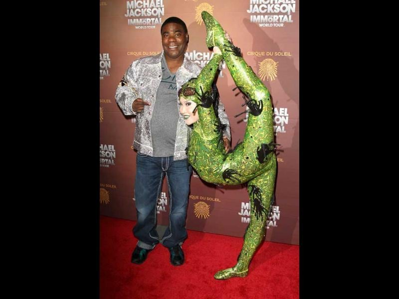 Actor-comedian Tracy Morgan poses with Cirque Du Soleil performer Baska at the