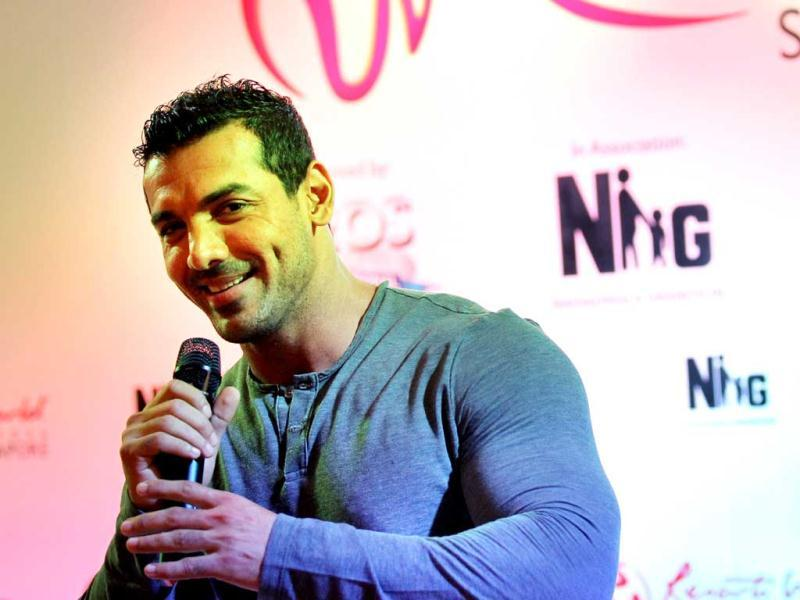 John Abraham interacts during the event. (AP Photo)