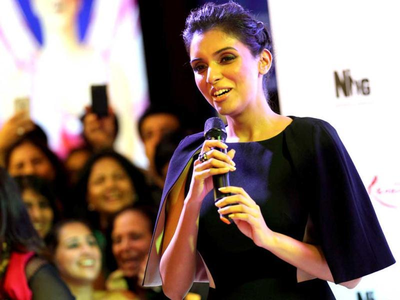 Asin Thottumkal speaks as she arrives for the premiere. (AP Photo)