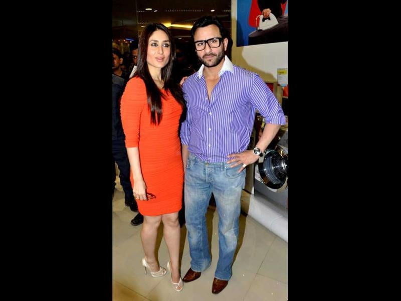 Kareena Kapoor poses with Saif Ali Khan at Agent Vinod's promotional event. We doubt if the figure hugging dress is working for her.