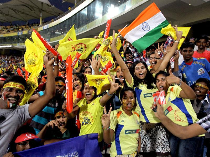 Chennai Super Kings fans pose during the opening IPL 5 match in Chennai. PTI Photo/R Senthil Kumar