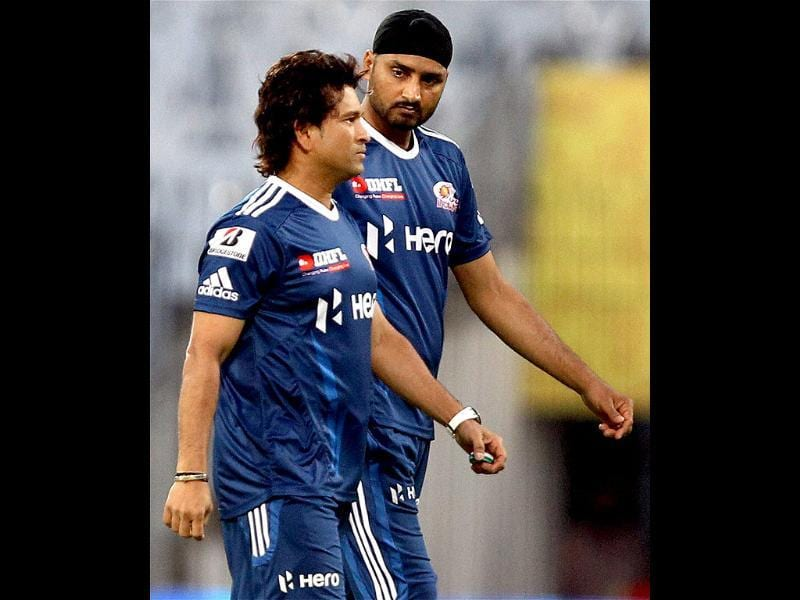 Mumbai Indians players Sachin Tendulkar and Harbhajan Singh chat before the start of their first IPL season 5 match against Chennai Super Kings in Chennai. PTI Photo/R Senthil Kumar