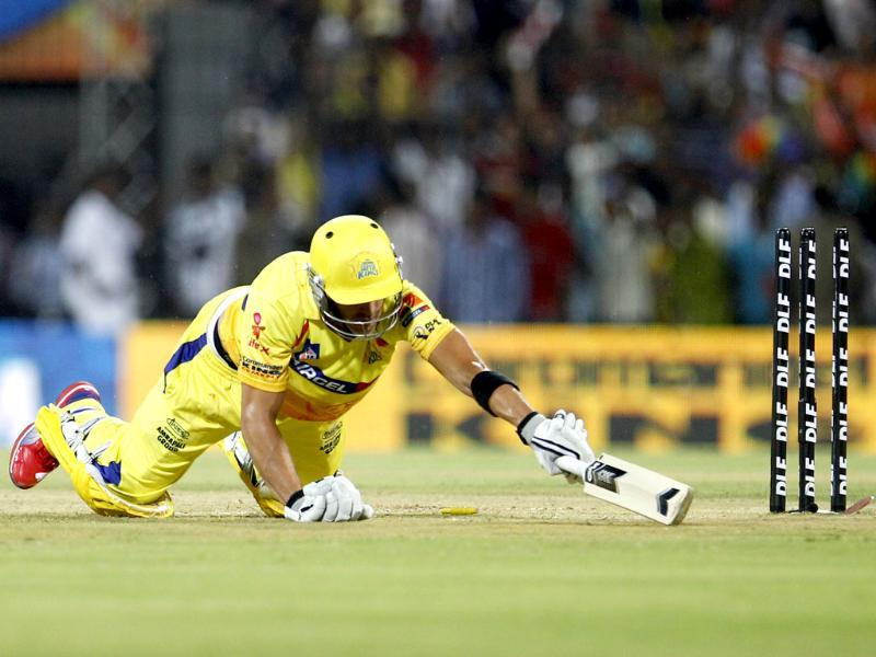 Chennai Super Kings batsman Faf du Plessis falls on the ground in an unsuccessful attempt to make it to the crease during their Indian Premier League match against Mumbai Indians in Chennai. AP Photo/Aijaz Rahi