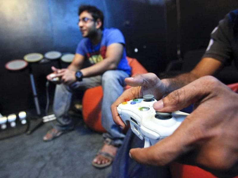 Employees of game company Dhruva Interactive play a game for which they designed the graphics, at their office in Bangalore. As gaming scales up, the advantages of outsourcing are becoming apparent to the firms on the US West Coast that dominate the sector. (Reuters)