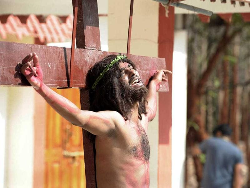 Catholics re-enact the crucifixtion of Jesus Christ during a 'passion play' tableau at The Mount Caramel Church in Hyderabad. Passion plays, a dramatic presentation depicting the suffering and death of Jesus Christ, are an integral part of Good Friday celebrations for Catholics. AFP/Noah Seelam