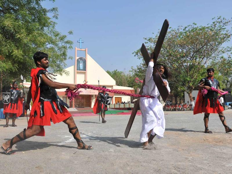 Catholics re-enact the crucifixtion of Jesus Christ during a 'passion play' tableau at The Mount Caramel Church in Hyderabad. Passion plays, a dramatic presentation depicting the suffering and death of Jesus Christ, are an integral part of Good Friday celebrations for Catholics. AFP/ Noah Seelam