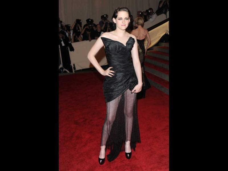 Kristen looks dressy in a black dress with a shear train at the Met Costume Gala (AP)