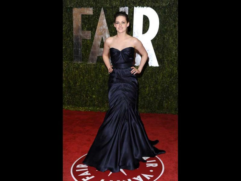Kristen Stewart in a flowing royal blue gown at the Vanity Fair Oscar Party (AP)