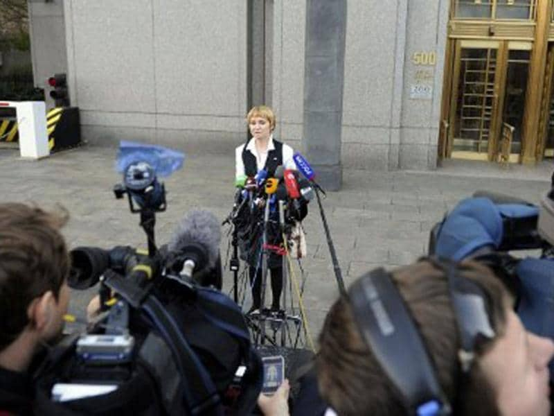 Alla, wife of Viktor Bout, speaks to the media outside Manhattan Federal court after his client was sentenced to 25 years in New York. Bout was convicted of conspiring to sell millions of dollars worth of weapons, including anti-aircraft missiles, to men he believed were terrorists intending to kill Americans. AFP PHOTO / STEPHEN CHERNIN