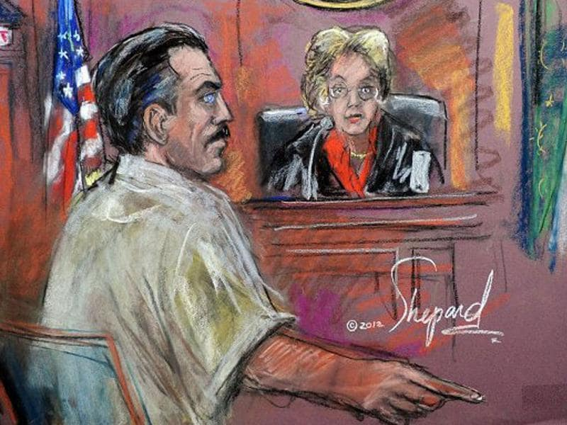 This courtroom sketch by Shirley Shepard shows Viktor Bout (in white) seated before Federal Judge Shira A. Scheindlin during his sentencing in New York. Bout was convicted of conspiring to sell millions of dollars worth of weapons, including antiaircraft missiles, to men he believed were terrorists intending to kill Americans. AFP PHOTO/Shirley Shepard