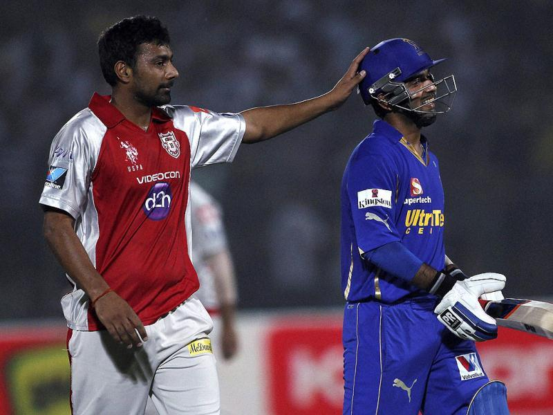Kings XI Punjab's Praveen Kumar congratulates Rajasthan Royals Ajinkya Rahane after Rahane was bowled on 98 runs during their IPL-5 match in Jaipur. (PTI Photo/Aman Sharma)